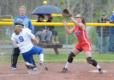 Ed Burke - The Saratogian 04/29/13 Queensbury's Amy Zuccaro gets back to third as South High's Teylor Nassivera waits for the throw during Tuesday's varsity softball matchup in Moreau.