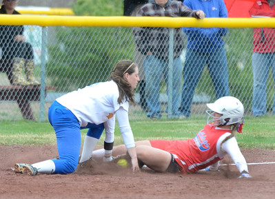 Ed Burke - The Saratogian 04/29/13 Queensbury's Taylor Clarke gets the out at third on South High's Brooke Snyder on a double play during Tuesday's varsity softball matchup in Moreau.