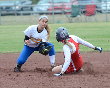 Ed Burke - The Saratogian 04/29/13 South High's Elyse Green is safe at second beating the throw to Queensbury's Katie Shevlin during Tuesday's game at Moreau Rec Park.
