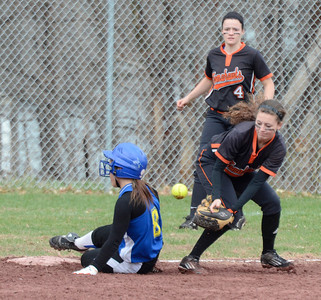 Ed Burke - The Saratogian 04/26/14 Galway's Haleigh Podrazik is safe at third after the throws gets away from Corinth's  Jordan Mjaatvedt during Saturday's Corinth Classic Softball Tournament.
