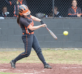 Ed Burke - The Saratogian 04/26/14 Corinth's Taylor Fedor connects for a base hit during Saturday's Corinth Classic Softball Tournament.