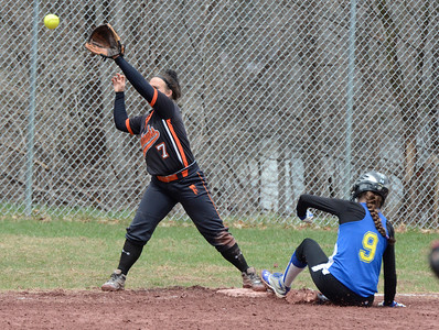 Ed Burke - The Saratogian 04/26/14 Galway's Jessi Freebern is safe at third beating the throw to Corinth's Taylor Fedor during Saturday's Corinth Classic Softball Tournament.