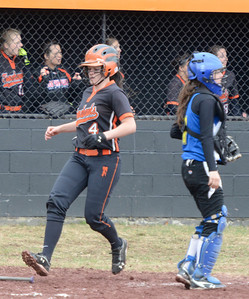 Ed Burke - The Saratogian 04/26/14 Corinth's Taylor Fedor scores on a hit by Cheyanne Mandigo during Saturday's Corinth Classic Softball Tournament. Galway catcher Sara LaRocca works the plate.