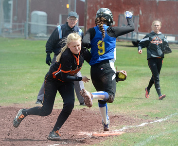 Ed Burke - The Saratogian 04/26/14 Corinth's Kaitlyn Plumeau gets the out on Galway's Jessi Freebern during Saturday's Corinth Classic Softball Tournament.