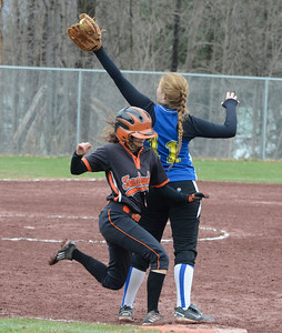Ed Burke - The Saratogian 04/26/14Galway's Emily Zawisa  gets the out on Corinth's Jordan Mjaatvedt after a sacrifice bunt during Saturday's Corinth Classic Softball Tournament.