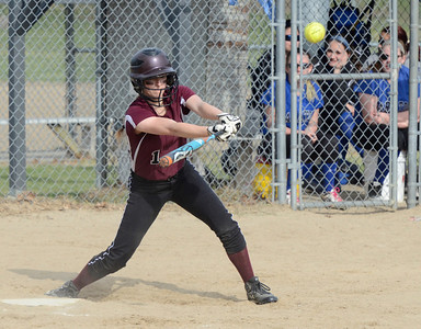 Ed Burke 04/25/14 Burnt Hills-Ballston Lake's Courtney Haff connects for a base hit during Friday's varsity softball matchup versus Saratoga at Veterans Memorial Park.
