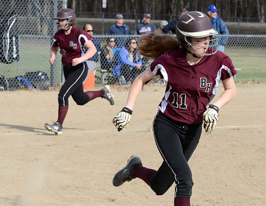 Ed Burke 04/25/14 Burnt Hills-Ballston Lake's Hayley Rutkey heads for home as Meghan Cullen goes to first after a 4th inning base hit during Friday's varsity softball matchup versus Saratoga at Veterans Memorial Park. Courtney Haff also scored for the Spartans on the play.