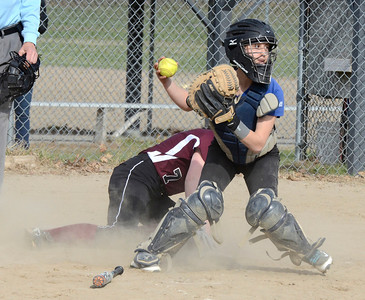 Ed Burke 04/25/14 Burnt Hills-Ballston Lake's Leah Pennings is safe at home as Saratoga catcher Sara Willner-Giwerc looks for a play during Friday's varsity softball matchup at Veterans Memorial Park.