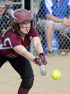 Ed Burke 04/25/14 Burnt Hills-Ballston Lake's Brittany Ryan lays down a bunt which gets her to  first during Friday's varsity softball matchup against Saratoga at Veterans Memorial Park.
