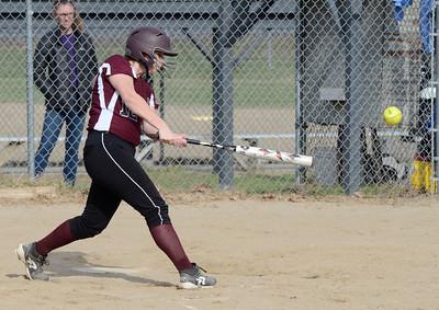 Ed Burke 04/25/14 Burnt Hills-Ballston Lake's Hayley Rutkey connects for a base hit during Friday's varsity softball matchup versus Saratoga at Veterans Memorial Park.