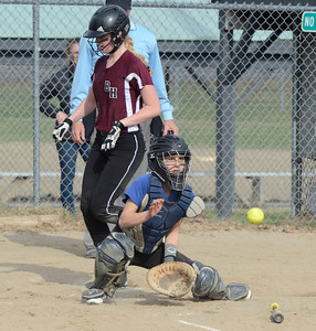 Ed Burke 04/25/14 Burnt Hills-Ballston Lake's Lilly Maggs is safe at home after a hit by teammate Meghan Cullen during Friday's varsity softball matchup at Veterans Memorial Park. Saratoga catcher Sara Willner-Giwerc behind the plat for the Blue Streaks.