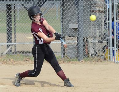 Ed Burke 04/25/14 Burnt Hills-Ballston Lake's Erin Sgambelluri connects for a base hit during Friday's varsity softball matchup versus Saratoga at Veterans Memorial Park.