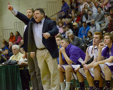 Ed Burke - The Saratogian 02/22/14 Saratoga Central Catholic coach Ken Mantia shouts from the sidelines during Saturday's Section ll Class C quarter-final at Hudson Valley Community College.