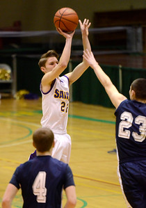 Ed Burke - The Saratogian 02/22/14 Saratoga Central Catholic's Ryan Czarnecki gets three for the Saints during Saturday's Section ll Class C quarter-final versus Rensselaer at Hudson Valley Community College.