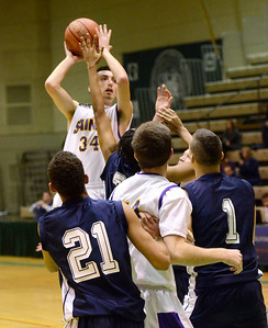 Ed Burke - The Saratogian 02/22/14 Saratoga Central Catholic's Evan Pescetti is shoots for two during Saturday's Section ll Class C quarter-final vesus Rensselaer at Hudson Valley Community College.