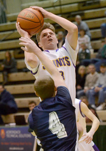 Ed Burke - The Saratogian 02/22/14 Saratoga Central Catholic's Luke Spicer shoots over Rensselaer's Jake Forgea during Saturday's Section ll Class C quarter-final at Hudson Valley Community College.