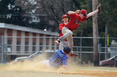 Erica Miller @togianphotog - The Saratogian:  Saratoga Springs High School held their first baseball home game on Monday afternoon at East Side Rec, April 14th, 2014, against Niskayuna. Saratoga's Jack Herman slides safely into second base as Nisky's Pat O'Brien caught a pass, backed up by Taylor Parks.