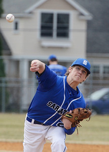 Erica Miller @togianphotog - The Saratogian:  Saratoga Springs High School held their first baseball home game on Monday afternoon at East Side Rec, April 14th, 2014, against Niskayuna. Saratoga's pitcher Daniel Coleman warmed up before Nisky's first up to bat.