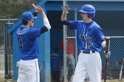 Erica Miller @togianphotog - The Saratogian:  Saratoga Springs High School held their first baseball home game on Monday afternoon at East Side Rec, April 14th, 2014, against Niskayuna. Saratoga's Devin Coffey gets a high-five from teammate Zach Guzi after scoring a run.