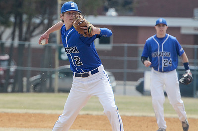 Erica Miller @togianphotog - The Saratogian:  Saratoga Springs High School held their first baseball home game on Monday afternoon at East Side Rec, April 14th, 2014, against Niskayuna. Saratoga's pitcher Daniel Coleman throws the ball to first base.