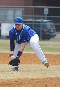 Erica Miller @togianphotog - The Saratogian:  Saratoga Springs High School held their first baseball home game on Monday afternoon at East Side Rec, April 14th, 2014, against Niskayuna. Saratoga's Eric Beer scooped up a catch, throwing it to first base.