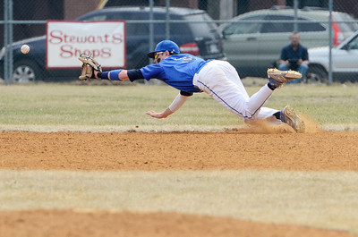 Erica Miller @togianphotog - The Saratogian:  Saratoga Springs High School held their first baseball home game on Monday afternoon at East Side Rec, April 14th, 2014, against Niskayuna. Saratoga's Zach Guzi dives to catch a hit, missing the glove.
