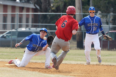 Erica Miller @togianphotog - The Saratogian:  Saratoga Springs High School held their first baseball home game on Monday afternoon at East Side Rec, April 14th, 2014, against Niskayuna. Nicholas Kondo caught the ball on second base as Nisky's Pat O'Brien ran to the base.