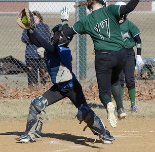 Ed Burke - The Saratogian 04/09/14 Shen's Courtney McDonnell scores on a leap of faith around an incoming throw to Saratoga catcher Sara Willner-Giwerc during Wednesday's game at Shen. McDonnell was safe on the play.