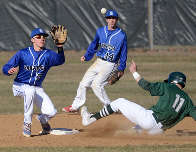 Ed Burke - The Saratogian 04/09/14 Shen's Brennan McCormack is safe at second beating the throw to Saratoga's Zach Guzi as Nick Kondo looks on during Wednesday's game at Shen.