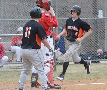 Ed Burke - The Saratogian 04/11/13 Schuylerville's Codie brown scores on a hit by teammate Matt Saddlemire during Friday's game at Schuylerville against Tamarac.