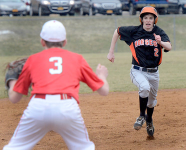 Ed Burke - The Saratogian 04/11/13 Tamarac third baseman hopes for a throw as Schuylerville's Matt Saddlemire scores from second on a hit by Jake Petralia during Friday's game at Schuylerville.