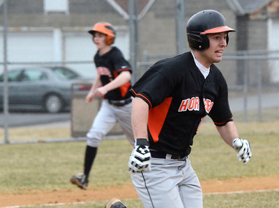 Ed Burke - The Saratogian 04/11/13 Schuylerville's Ed Mahay doubles in the first inning driving in Matt Saddlemire during Friday's game at Schuylerville against Tamarac.