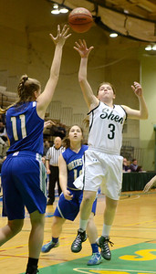 Ed Burke - The Saratogian 03/08/14 Shen's Madi Shea shoots over Emilee Norris during Saturday's Class AA regional matchup against Cicero-North Syracuse in Troy.
