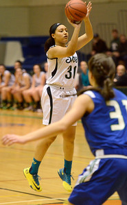 Ed Burke - The Saratogian 03/08/14 Shen's Amanda Lee gets three for the Lady Plainsmen during Saturday's Class AA regional matchup against Cicero-North Syracuse in Troy.