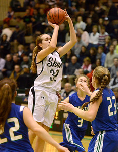 Ed Burke - The Saratogian 03/08/14 Shen's Carly Boland shoots during Saturday's Class AA regional matchup against Cicero-North Syracuse in Troy.