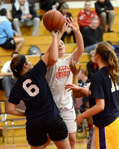 Ed Burke - The Saratogian 03/11/14 Suburban Council's Anne Mahoney from Saratoga is fouled by Big Ten's Keely Santiago of Amsterdam during Tuesday's Exceptional Senior Basketball matchup at Niskayuna. Big Ten's Mary Pattison of Troy looks on at right.