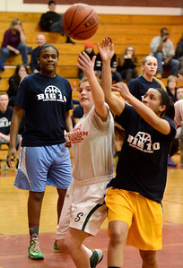 Ed Burke - The Saratogian 03/11/14 Suburban Council's Madi Shea of Shenendehowa battles for a rebound with Big Ten's Taulie Frierson of Troy during Tuesday's Exceptional Senior Basketball matchup at Niskayuna.