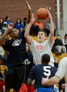 Ed Burke - The Saratogian 03/11/14 Suburban Council's Noah Arciero of Saratoga Springs shoots under pressure from  Big Ten's Jerriam Teddars of Catholic Central during Tuesday's Exceptional Senior Basketball matchup vs Big Ten at Niskayuna.
