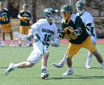 Ed Burke - The Saratogian 04/12/14 Skidmore's Henry Thomsett advances as Clarkson defender Sean Mech blocks during Saturday's lacrosse matchup at Skidmore.