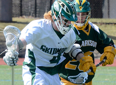 Ed Burke - The Saratogian 04/12/14 Skidmore's Nate Mason pushes past Clarkson defender Ben Paprocki during Saturday's lacrosse matchup at Skidmore.