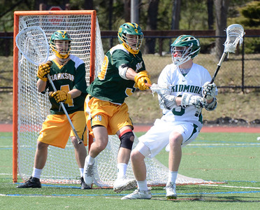 Ed Burke - The Saratogian 04/12/14 Skidmore's Kevin Mulvey is pressured by Clarkson's Rick Clement as goalie Nick Strandholm looks on during Saturday's lacrosse matchup at Skidmore.