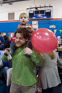 Eric Jenks - The Saratogian Matt Dickson carries his son Isaac on his shoulders during the annual Purim festival celebration at the Gavin Park Rec. Center Sunday, March 16, 2014.
