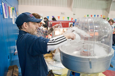 Eric Jenks - The Saratogian Tom Klingerman makes cotton candy during the annual Purim festival celebration at the Gavin Park Rec. Center Sunday, March 16, 2014.