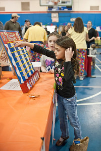 Eric Jenks - The Saratogian Emma Maiorella plays a game during the annual Purim festival celebration at the Gavin Park Rec. Center Sunday, March 16, 2014.
