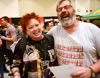 Soaking up the suds, Lisa Herider and Jim Roemer of Johnstown share a laugh while attending Saturday's Saratoga Beer Summit.