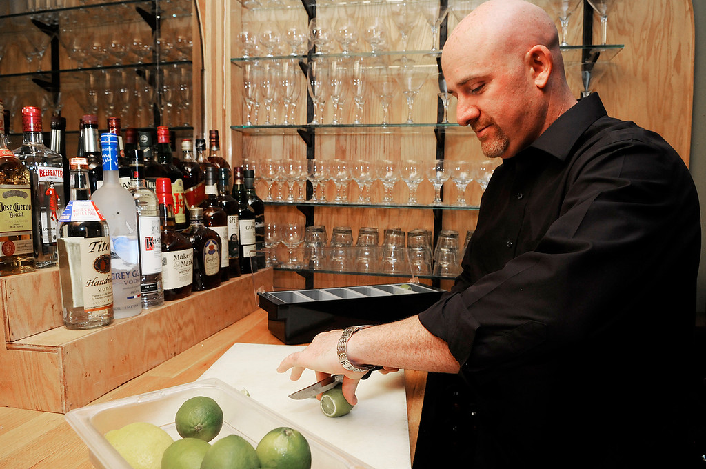 . Erica Miller - The SaratogianAugie\'s restaurant will be opening their doors Wednesday evening in their new temporary home at the former Manna\'s on Low Street in Ballston Spa. Manager/Bartender Tory Cameron sliced up limes in preparation. Augie\'s restaurant was burnt in this summer.SAR-l-AugieOpens3