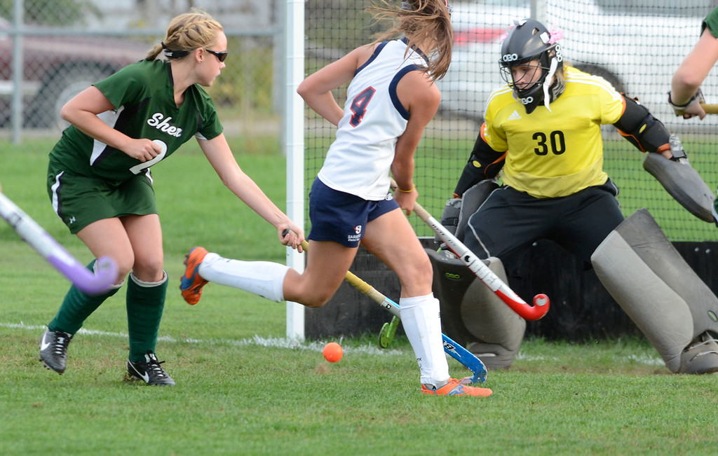 . Shen defender Kendall Pelletier and goalie Melissa Nealon watch a shot by Saratoga\'s Kate Dennett go wide during Wednesday\'s varsity field hockey game at Saratoga.  Ed Burke -  The Saratogian 10/16/13