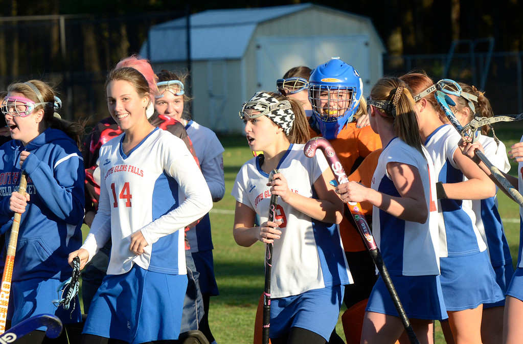 . Ed Burke - the Saratogian South High Bulldogs celebrate Tuesday\'s varsity field hockey semi-final win over Glens Falls.