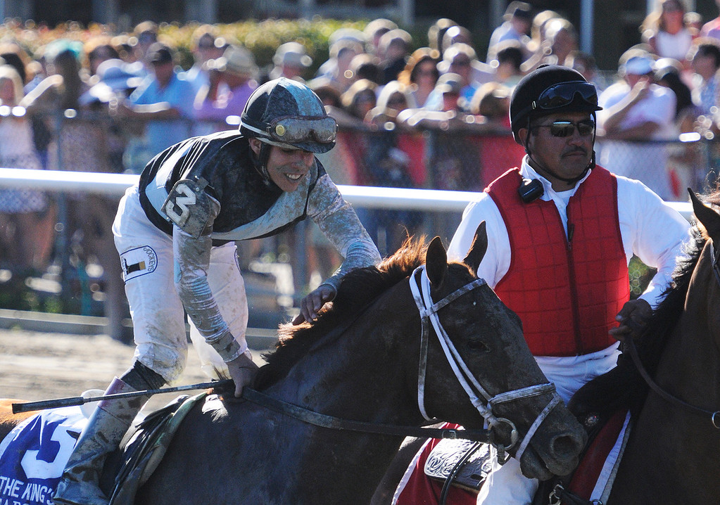 . Capo Bastone ridden by Irad Ortiz, Jr., and trained by Todd Pletcher won the 29th Running of The Foxwoods King\'s Bishop on Saturday at the Saratoga Race Course.Photo Erica Miller/The Saratogian 8/24/13 KingsBishopEM5