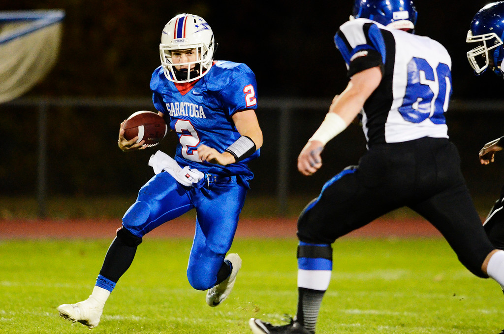. Erica Miller - The Saratogian @togianphotog      Saratoga\'s Jake Eglintine runs down the field during their playoff football game against LaSalle\'s John Paul Petalas on Friday evening under the lights in Saratoga. SAR-l-SarFootball5